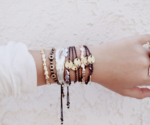 feather, gold, and jewelry image