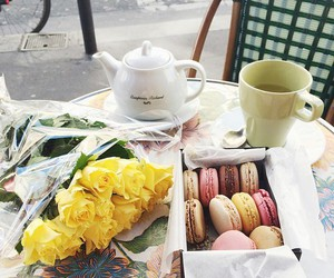 flowers, macaroons, and tea image