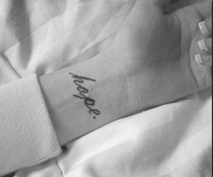 black and white, tattooed, and wrist image