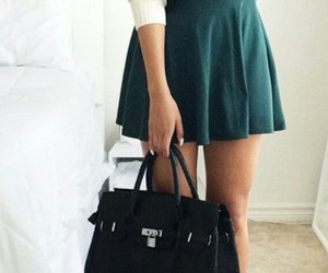 black purse, black scarf, and white nails image