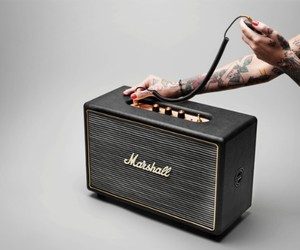 gold, speakers, and tatto image