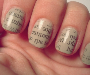 nails and newspaper image