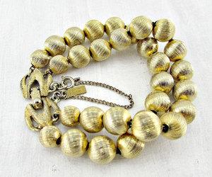 gold bead bracelet, double strand bracelet, and vintage monet bracelet image