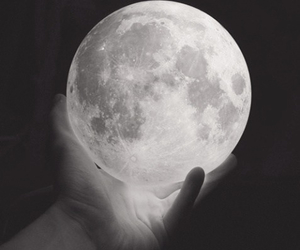 moon, hand, and black and white image