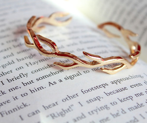 bracelet, gold, and book image