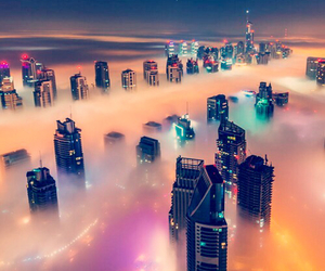 city, light, and fog image