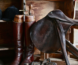 saddle, boots, and horses image