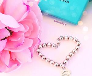 charm bracelet, pink flower, and tiffany image
