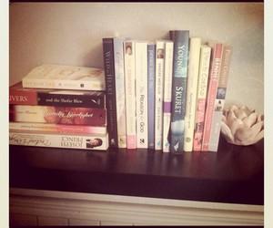 books, flower, and bookshelf image
