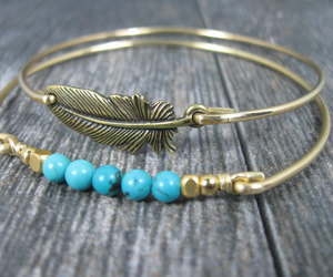 feather, turquoise, and gold bracelet image