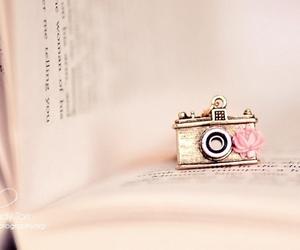 book, camera, and pink image