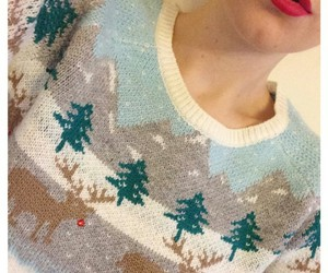 red lipstick and christmas sweater image