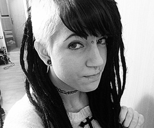 dreads, piercing, and long hair image