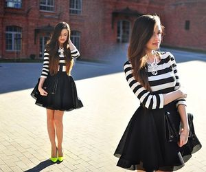 high heels, striped top, and black mini skirt image