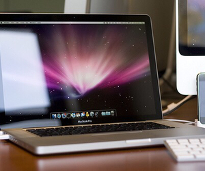 apple, iphone, and macbook image
