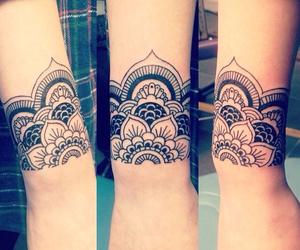 ink, wrist tattoo, and mandala tattoo image