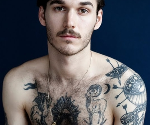 men and tattoo image