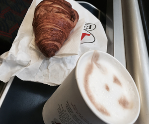 coffee, croissant, and traveling image