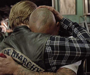 Charlie Hunnam, happy, and sons of anarchy image