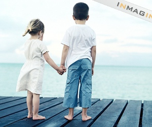 dock, girl and boy, and ocean image