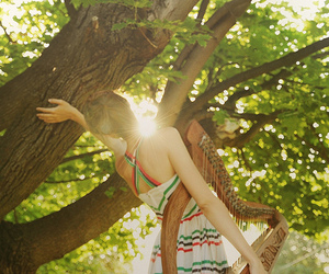 girl, tree, and harp image