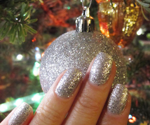 december, hand, and ornaments image