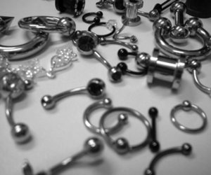 piercing, black and white, and Plugs image