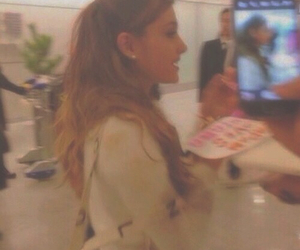 blurry, low quality, and ariana grande image