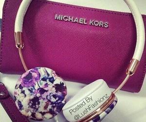Michael Kors and headphones image