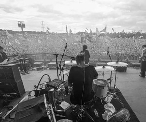 band, stage, and black and white image