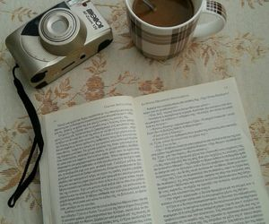 book, camera, and cup image