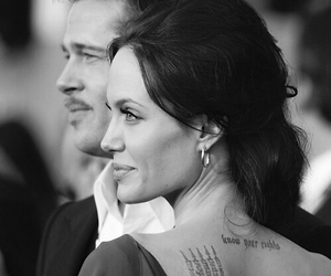 Angelina Jolie, brad pitt, and tattoo image