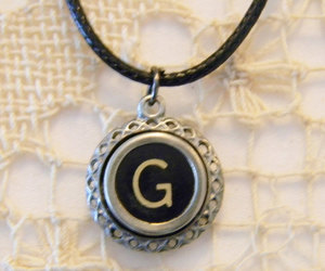 letter g, black necklace, and typewriter necklace image