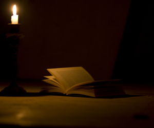 book, candle, and light image
