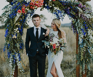 wedding, couple, and flowers image
