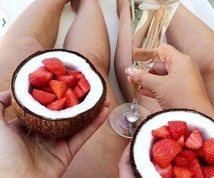 champagne, coconut, and strawberries image