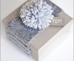 pompon, craft paper, and wrap gift image