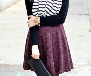 black clutch, purple skirt, and striped scarf image