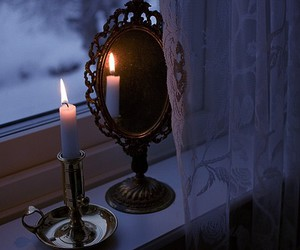 candle, mirror, and night image