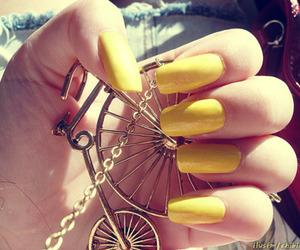 nails, yellow, and bike image