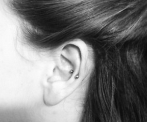 piercing and snug image