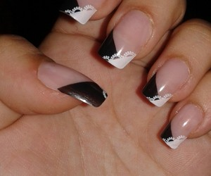 black nails and black and white nails image