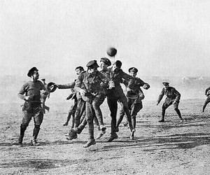 football, soldiers, and war image