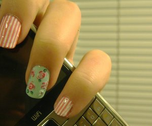 celphone, fingers, and floral image
