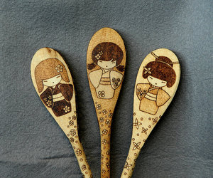 kitchen decor, kokeshi doll, and wooden spoons image