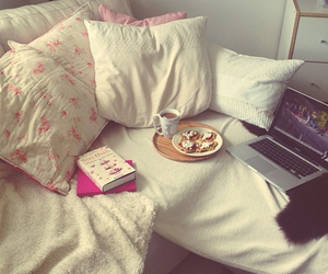 bed, laptop, and book image