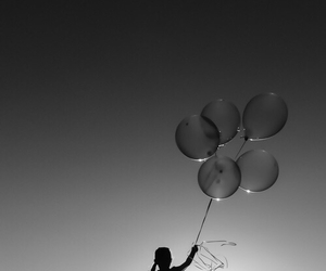 black and white and balloons image