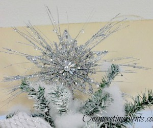 silver christmas tree and silver tree topper image