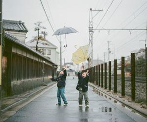 children, rain, and umbrella image