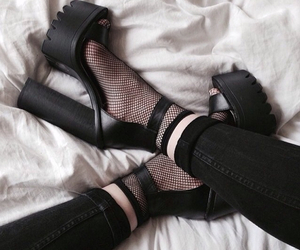 black, fishnets, and jeans image
